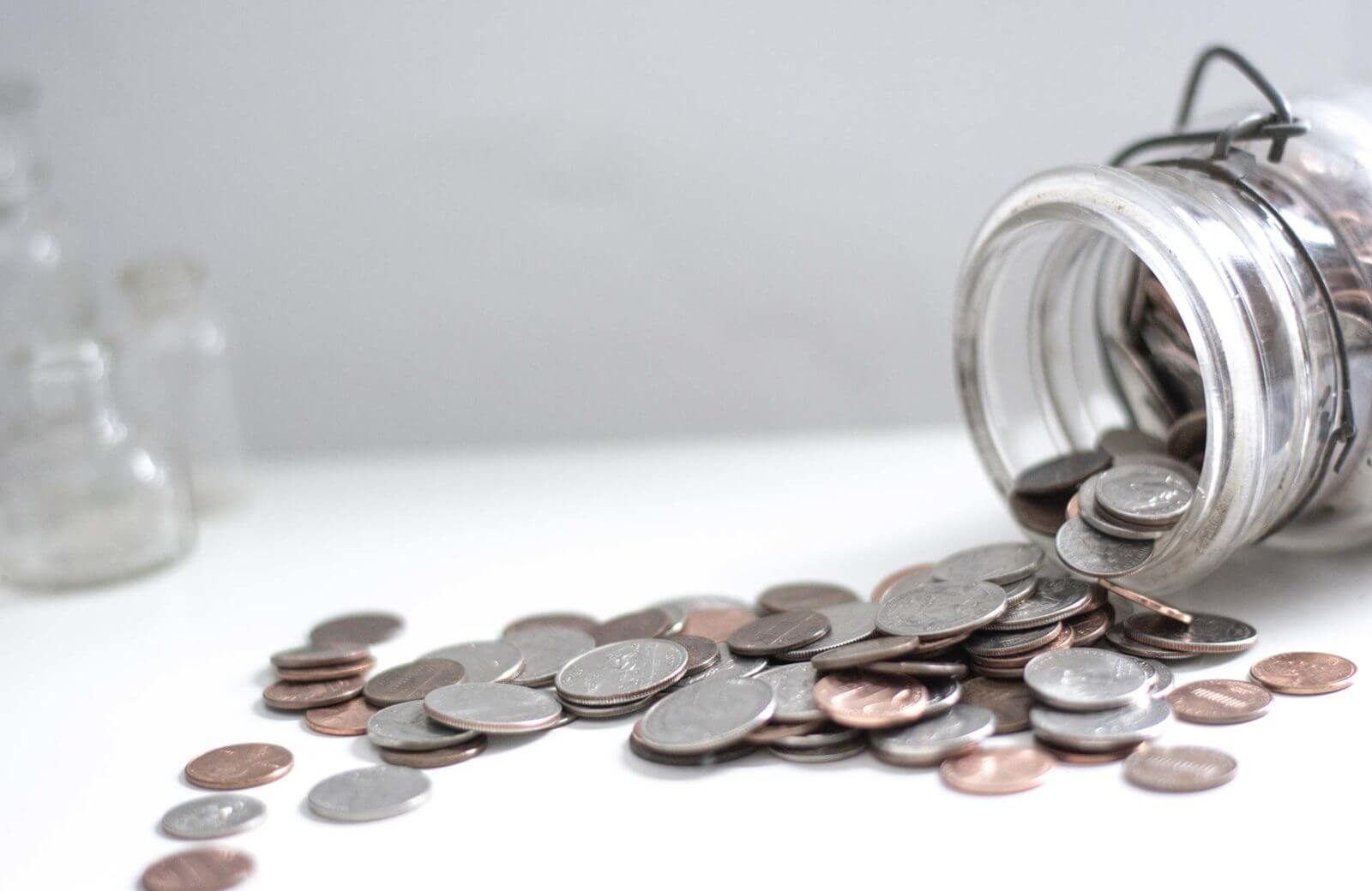 Coins Coming From Jar